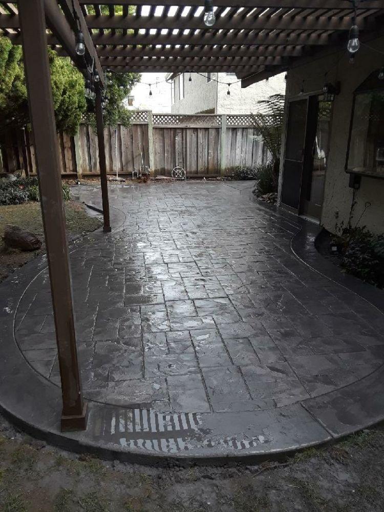 Backyard patio renovation with concrete
